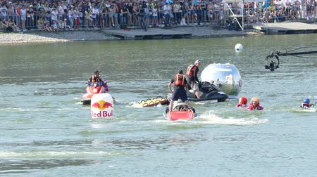 participante : JUL 26, 2015 MOSCOW: Red bull flugtag day. Evacuation team out of the water after the jump. Red Bull Flugtag is an event in which competitors attempt to fly homemade human-powered flying machines.
