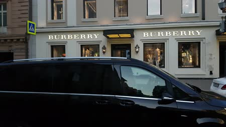 kirakat : MAY 11, 2018, MOSCOW, RUSSIA: Peope traffic in front of Burberry boutique in Petrovka st. Stock mozgókép