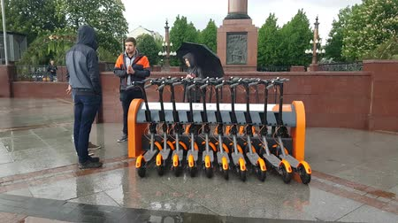 ev : MAY 19, 2018, MOSCOW, RUSSIA: Electric Kick scooter in sharing parking lot. New sharing business project started 19 of may 2018 in Moscow.