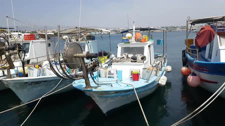 greece flag : MAY 22, 2018, PAPHOS, CYPRUS: Small Fishing Boats In Paphos Harbor, Mediterranian sea, Cyprus.