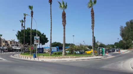 busz : MAY 22, 2018, PAPHOS, CYPRUS: Traffic On The City bus station in harbour, Paphos City, Cyprus Stock mozgókép