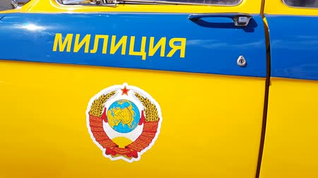 public officer : APR 20, 2018, MOSCOW, RUSSIA: An old Soviet police car with a siren, a flasher and USSR coat of arms on the door. Stock Footage