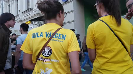 league : JUN 16, 2018 MOSCOW, RUSSIA: Colombian funs with sign on T-shirt walking by the street, back view