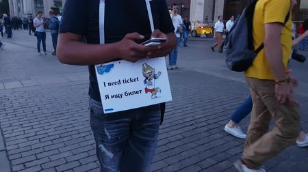 final : JUN 16, 2018, MOSCOW, RUSSIA: Fun with Looking for ticket sign on the street before soccer game