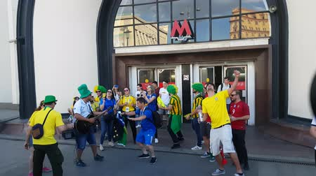 brazil : JUN 16, 2018, MOSCOW, RUSSIA: Brazilian funs having fan on the street. People in national soccer team wear posing for photographer in Moscow