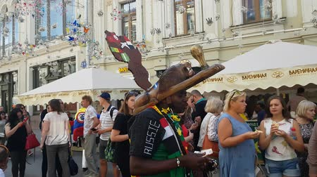 lion : JUN 27, 2018 MOSCOW, RUSSIA: The soccer souvenirs seller from Africa in the street.