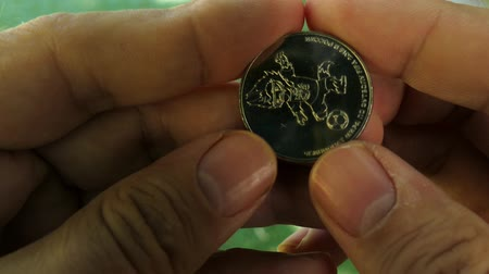jubileu : JUL 01, 2018 MOSCOW, RUSSIA: Jubilee Coin of 25 rubles with FIFA world championship Zabivaka symbol