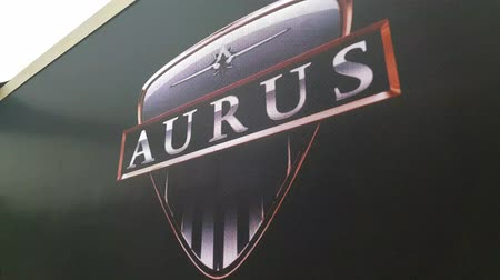 limuzína : Brand new Aurus logo on the wall at the exhibition MIMS 2018. SEP 03, 2018 MOSCOW, RUSSIA Dostupné videozáznamy
