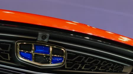 plated : Close-up Geely logo in mims 2018 exposition. Geely is the famous Chinese automobile factory. SEP 03, 2018 MOSCOW, RUSSIA