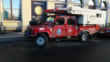 Brutal lend rover defender with numerous off road raids stickers and flags of the countries in which he visited. Saint Petersburg, RUSSIA, OKT 19, 2018