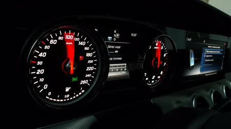 metrik : Speedometer and tachometer with additional instruments on Mersedes car dashboard.