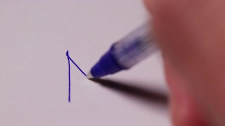 отказ : A mans hand writes the word NO with an exclamation mark on a white sheet of paper. Disclaimer Concept