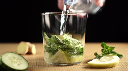 sassy : Water from the bottle with chopped ingredients. Lemon, cucumber, imbar, mint. Sassi for weight loss. Stock Footage