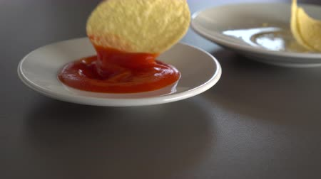 Spicy tomato sauce, juicy each. On a gray table. The food is in white plates Wideo