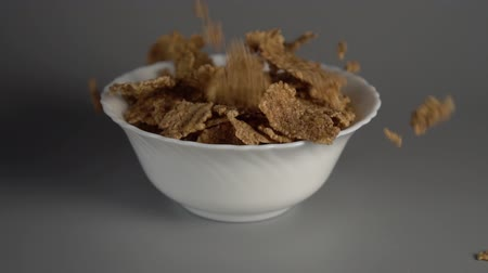 oat flakes : Slow down into gray kitchen table. Slow motion