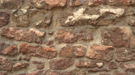 destroyed building : The ancient stone wall of the historic building destroyed by time Stock Footage