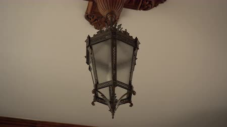 desenli : Ancient wrought iron patterned lantern on the white ceiling with frosted glass