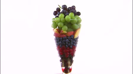 nektarinka : assorted fruit in vase on white background