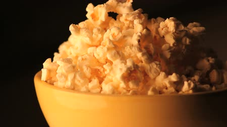 full bucket : spinning bowl of popcorn zoomed out