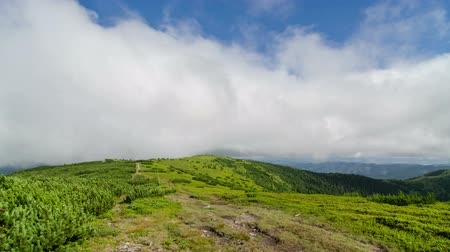 hiking : Clouds flying over mountain ridge and hiking trail time lapse Stock Footage