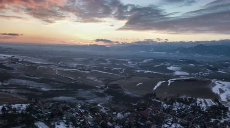 lowland : Aerial view of sunset over low land country and small village. Hyper time lapse