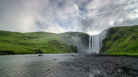 skogafoss : Morning sky over waterfall Skogafoss in Icelandic nature Time lapse