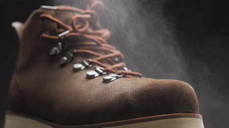A waterproof spray is applied to the shoes