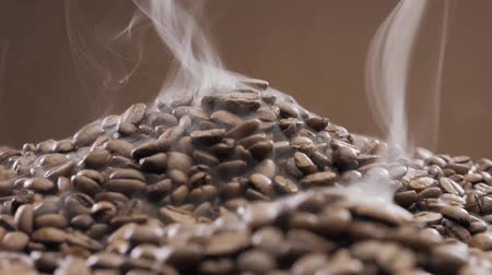 dark roast : offee beans rotate while roasting. Smoke comes from coffee beans. Stock Footage