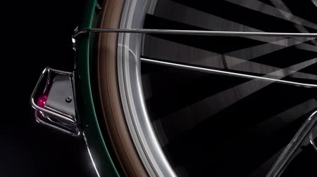 aro : A bicycle wheel spinning, close up shot
