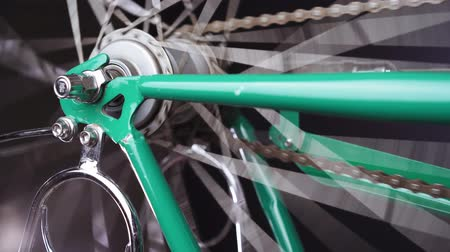 axle : A bicycle wheel spinning, close up shot
