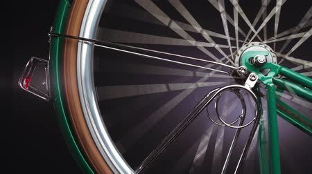 alumínium : A bicycle wheel spinning, close up shot