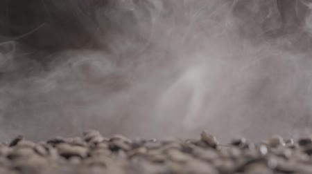 flexão : Coffee beans burst and fall down through the smoke Stock Footage