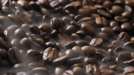 çeşnili : Coffee beans rotate while roasting. Smoke comes from coffee beans.