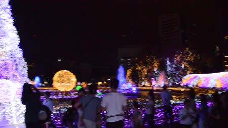 gimmick : Bangkok Thailand December 16, 2017 :  ambiance of traveler visit and watch LED light show in Thailand illumination festival 2017 on night