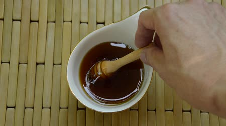 fructose : hand picking wooden honey scoop from cup