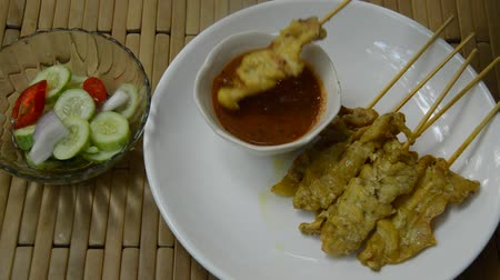 cucumber : pork satay dipping peanut sauce and pickled vegetable cup Stock Footage