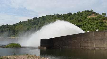 gát : water splashing from floodgate Khun Dan Prakarn Chon huge concrete dam in Thailand