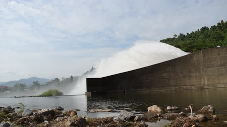 water splashing from floodgate Khun Dan Prakarn Chon huge concrete dam in Thailand