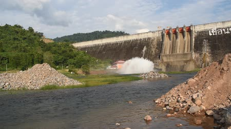 dançarinos : water splashing from floodgate Khun Dan Prakarn Chon huge concrete dam in Thailand