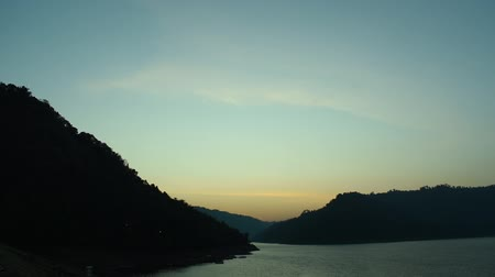 sunrise behind mountain on river in Thailand Стоковые видеозаписи
