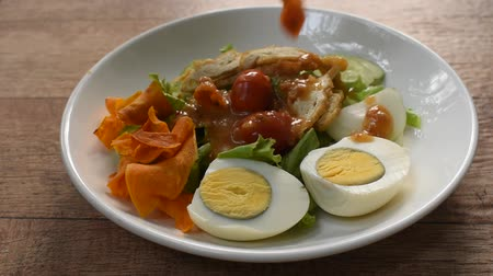 Islamic salad vegetable and boiled egg topping crispy fried taro dressing sweet bean sauce halal food on plate