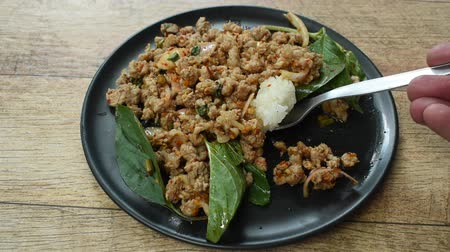 pimenta : Thai spicy minced pork salad eat couple with sticky rice scooping by silver spoon