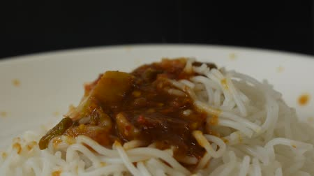 サバ : rice noodles dressing spicy mackerel curry sauce on plate 動画素材