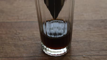 coffee drip mixed by hot water dropping on glass Stockvideo
