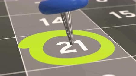 primeiro plano : Pin on the date number 21. The twenty-first, day of the month is marked with a blue thumbtack. 4K video animation. Stock Footage