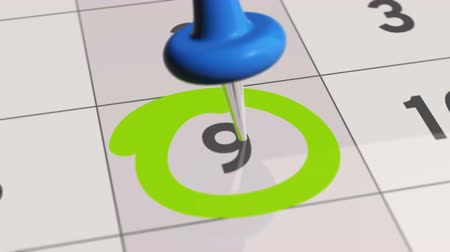 rajzszeg : Pin on the date number 9. The ninth day of the month is marked with a blue thumbtack. 4K video animation.