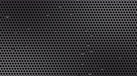 perforation : Circle perforated sheet metal with drops of water. 4K UHD video loop animation background.