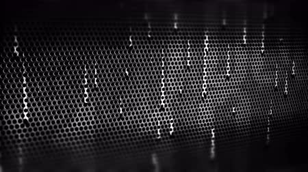 perforation : Drops of water on a perforated metal plate. 4K UHD video loop animation background. Stock Footage