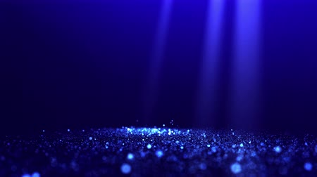 video effects : Blue glittering particles with spotlights and blurred background. UHD 4K seamless loop video.