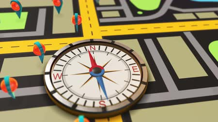 point of interest : Navigation compass with map. The hand pointing toward the point of interest. Stock Footage